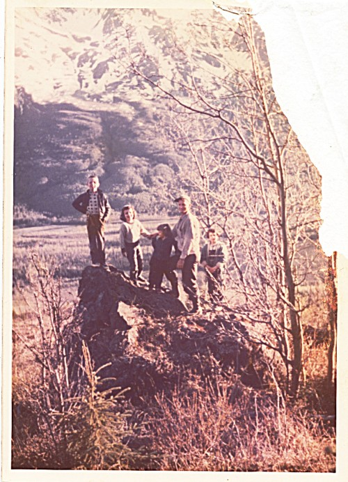 1958 family on the big rock above hut - dad found this spot when he first discovered the homestead site - damaged photo, but homepfully I'll come across a slide or negative -- I've always felt that my 7-year-old self is excluded in this picture -- I also can see my sadness in this one