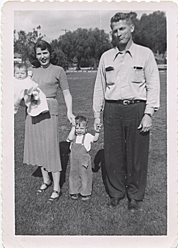 """1951 picture of me with mom, dad and John - mother wrote on back of photo - """"I can remember trying to hold John still so his picture could be taken.  What a live wire - already had his pocket torn.  You look just like my baby pictures.  So cute - oh, how fast time flies!""""  (written on this duplicate and sent to me March, 26, 1976)"""