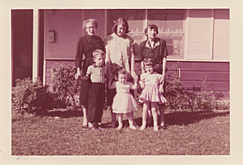 1955, probably Glendora house in California, Linda in front of grandmother, Cindy in front of mother (expecting Sharon), John in front of ? - not sure, maybe Aunt Carolyn