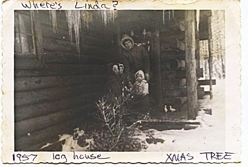 Age 6 - Mother's magic -- Linda has completely vanished from the family picture of bringing in the Christmas tree