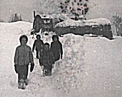 1959 December, first winter on the mountain, I'm in 3rd grade, Jamesway with gray trailer parked beside it