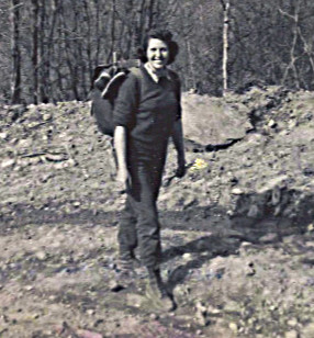 "1959 May - ""Starting Home"" - Mother walking the homestead mountain road"