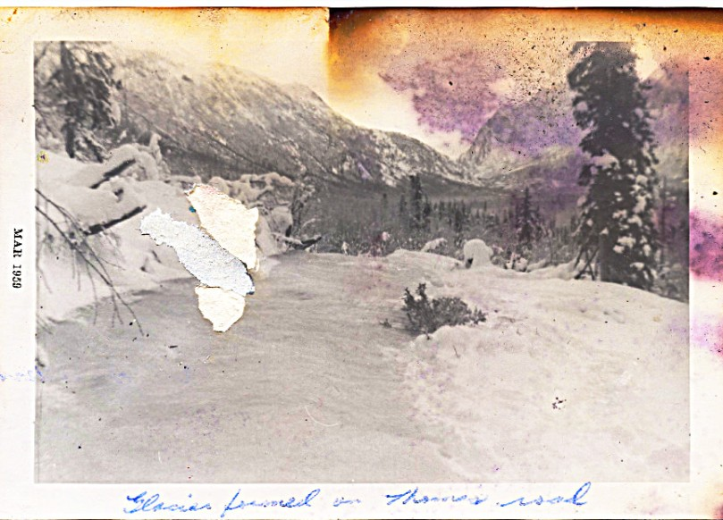 1959 - May - glacier formed over neighbor Thomas' road - like they did on our road.  These homesteaders staked their claim further back on the valley floor, past Pollard's, moved out and never returned
