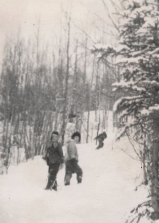 Cindy and I 1960 on the mountain walk home -- in 50 years, in 2009, those trees have grown, the land is gone to our family, subdivided, with a paved road