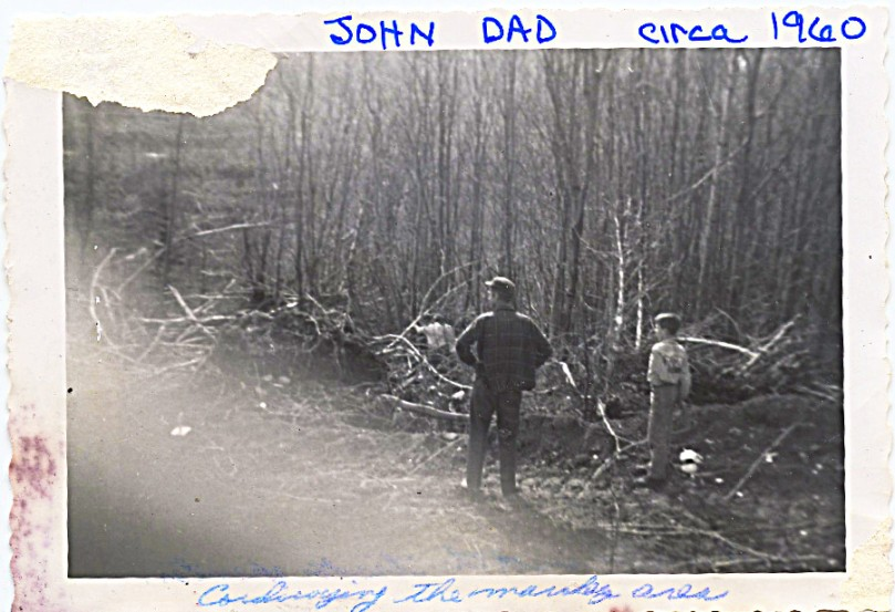1960 ish dad and john watching 2nd road going in -- I wish I could restore this photo