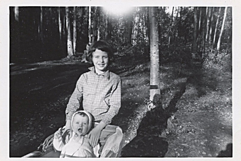 1961, I am 9 almost 10 - Here's a happy picture of me with Baby David, taken in yard at Eagle River log house, Alaska
