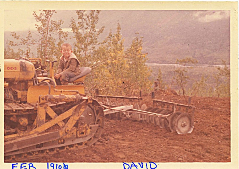 1966 clearing 2nd field dave on tractor