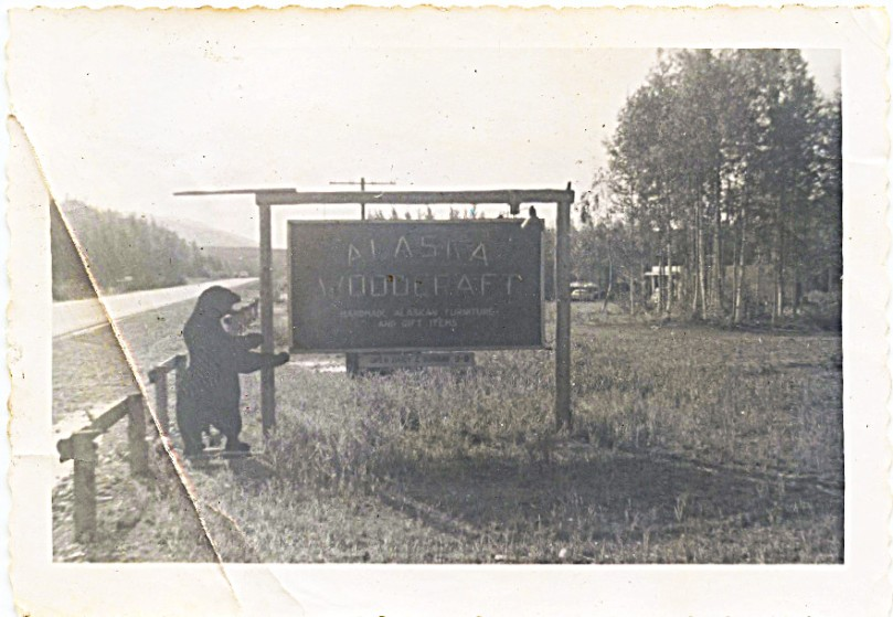Mother writes in her early 1958 letters about working at Bockstahler's Alaskan Woodcraft Shop.  This is a picture of their sign along the old highway from Anchorage looking toward the river.