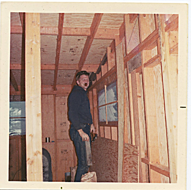 Maybe 1968?  Dad with his pipe adding on the bedroom end to the Jamesway.