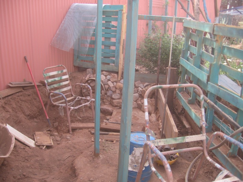 finishing the adobe mine hole - not sure I can salvage those chairs!