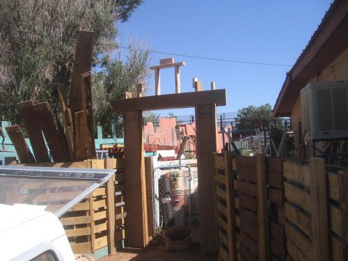 Again - the super fun project's beginning above the gateway (looking toward Mexico)  HINT:  getting read to stucco the pallet fence - and THEN SOME!!