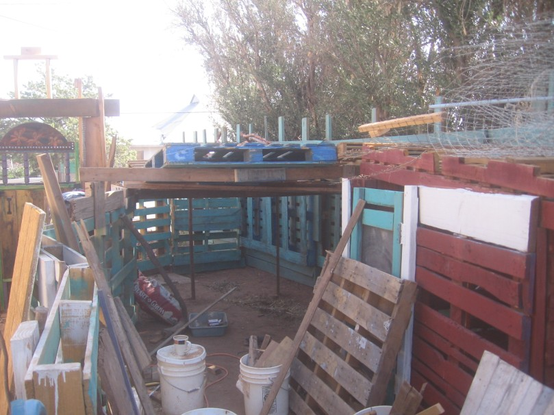 The structure spans the width of the goat pen